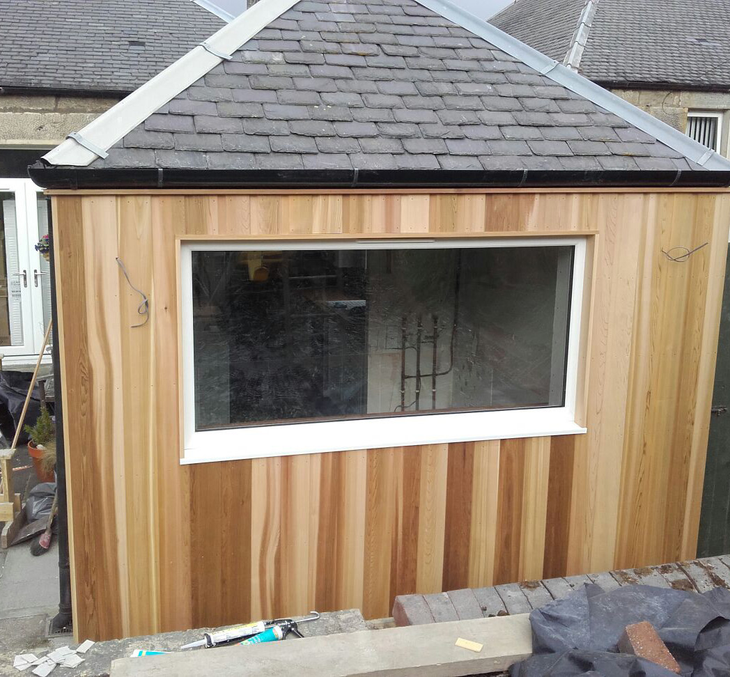 Picture window creation with cedar cladding