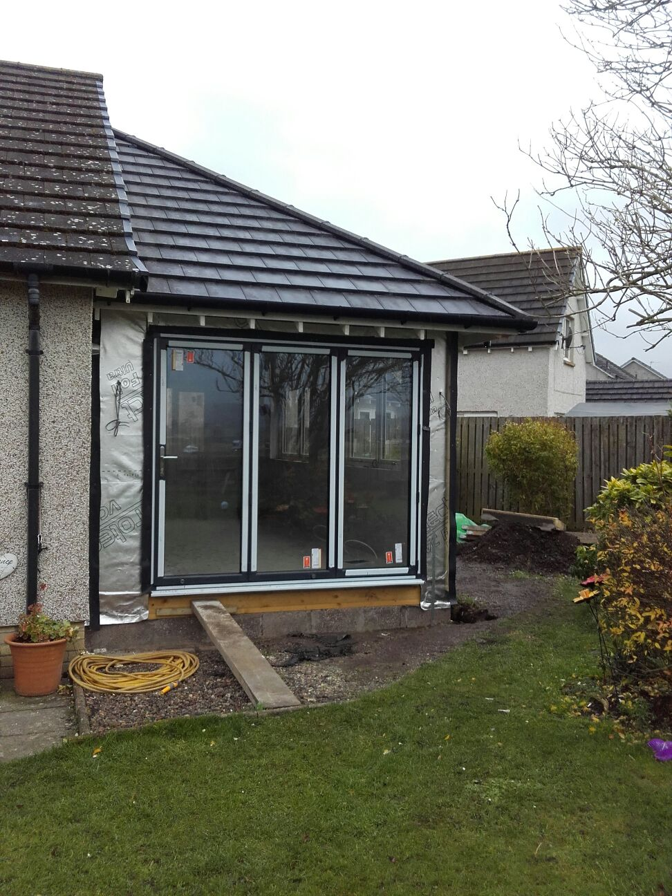 Sun room extension/bifold doors