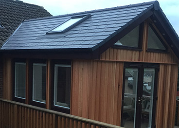 Sunroom extension - Cedar Clad with uPVC Patio Doors/Windows