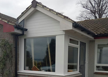Porch extension which extends/enhance existing entrance area complete with a picture window
